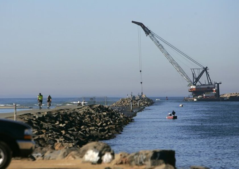 Work on the south jetty of the Mission Beach Channel has begun thanks to Federal stimulus money. A company which has a rock quarry on Catalina Island is providing the rocks to resurrect the storm-damaged jetty.