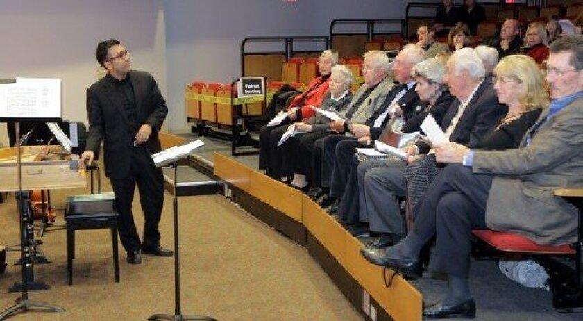 Music Director Ruben Valenzuela participates in the pre-concert discussion.