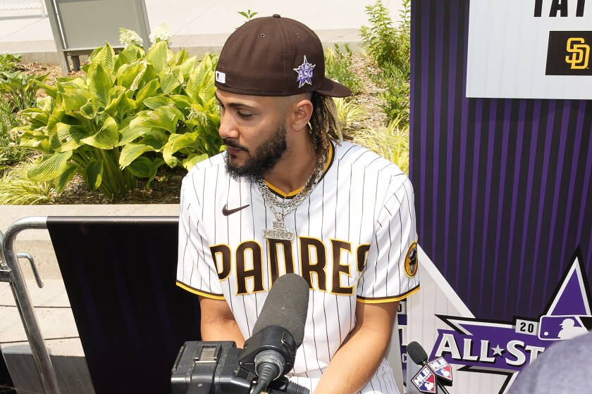 National League's Fernando Tatis Jr., of the San Diego Padres, speaks with the media prior to batting practice for the MLB All-Star baseball game, Monday, July 12, 2021, in Denver. (AP Photo/David Zalubowski)