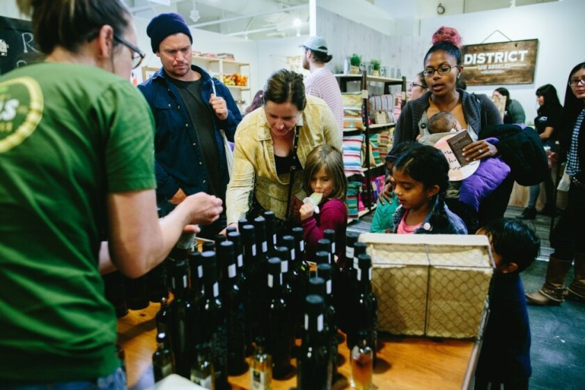 Families sample local artisanal goods at an Artisanal L.A. market.
