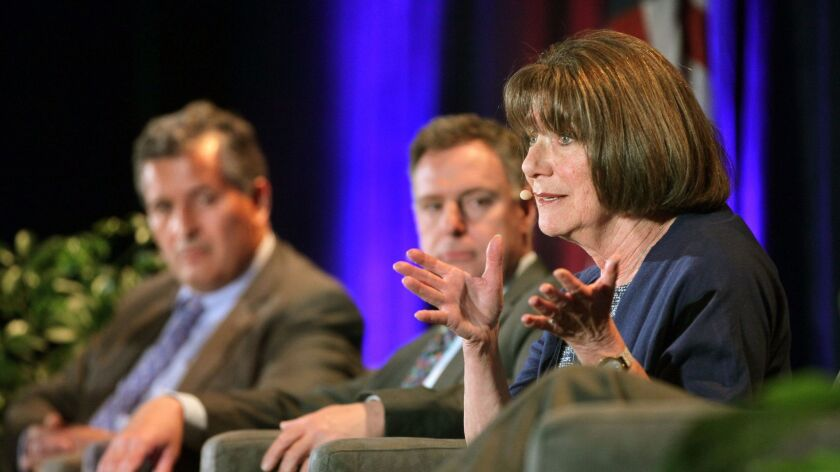 Rep. Susan Davis, D-San Diego (right), speaks at the Congressional Luncheon at the Marriott Marquis San Diego hotel on April 27, 2015. Alongside her from left to right are Reps. Juan Vargas and Scott Peters, D-San Diego.