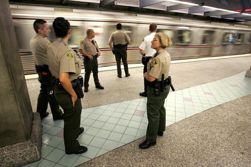 Sheriff's deputies staff the platform of the Hollywood-Highland Metro Red Line station. A new Metro hotline, staffed by counselors, will connect riders who have been harassed with professional assistance.