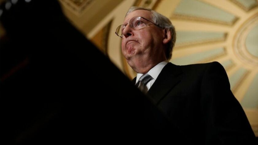 Senate Majority Leader Mitch McConnell speaks with reporters following the weekly policy luncheons at the Capitol this week.