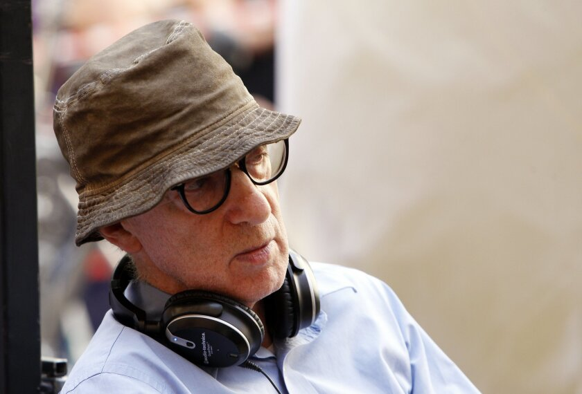 "FILE - This July 14, 2011 file photo shows U.S. director Woody Allen in central Rome. Allen's upcoming film ""Magic in the Moonlight"" will be a 1920s caper set in southern France. The film stars Colin Firth, Emma Stone and Marcia Gay Harden.No release date was announced for ""Magic in the Moonlight."" It's Allen's seventh film for Sony Pictures Classics. (AP Photo/Andrew Medichini, File)"