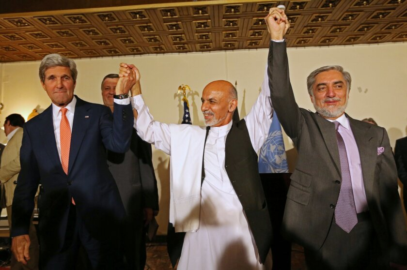 FILE - This July 12, 2014 file photo shows. from left, Secretary of State John Kerry, Afghanistan's presidential candidate Ashraf Ghani Ahmadzai, and Afghan presidential candidate Abdullah Abdullah during a joint news conference in Kabul, Afghanistan. The Obama administration on Thursday stepped up efforts to press Afghanistan's two feuding presidential candidates to end their dispute over June elections, accept the results of an ongoing audit of all ballots and form a national unity government by early September. On an unannounced visit to Kabul, Kerry made personal appeals to both candidates _ former Foreign Minister Abdullah Abdullah and former Finance Minister Ashraf Ghani Ahmadzai _ to understand the urgency of finding a resolution before the upcoming NATO summit in Wales on September 4, according to officials traveling with Kerry. (AP Photo/Rahmat Gul, File)