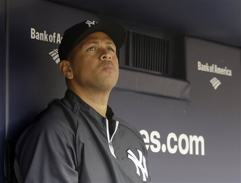 FILE - This April 13, 2013, file photo shows New York Yankees' Alex Rodriguez sitting in the dugout during a baseball game at Yankee Stadium in New York. Three MVP awards, 14 All-Star selections, two record-setting contracts and countless controversies later, A-Rod is the biggest and wealthiest target of an investigation into performance-enhancing drugs, with a decision from baseball Commissioner Bud Selig expected on Monday, Aug. 5, 2013. (AP Photo/Kathy Willens, File)