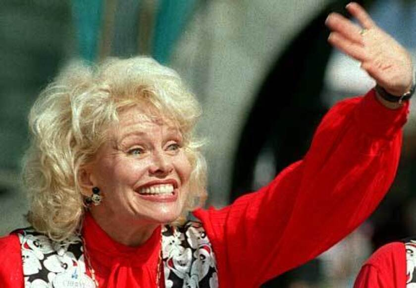 "Cheryl Holdridge waves to a fan at Disneyland in 1995 during a 40th anniversary gathering of the original ""Mickey Mouse Club's"" Mousketeers. ""She was a good technical dancer, but I think she was picked mostly because she had this angelic look and a great smile,"" castmate Doreen Tracey said."