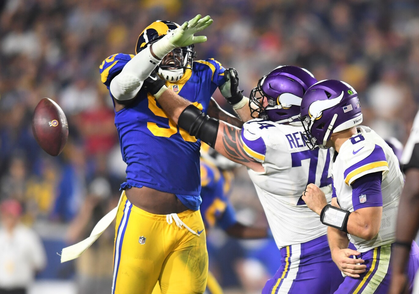 Rams defensive lineman Michael Brockers forces Vikings quarterback Kirk Cousins into a fumble late in the 4th quarter. The Rams recovered to preserve the win.