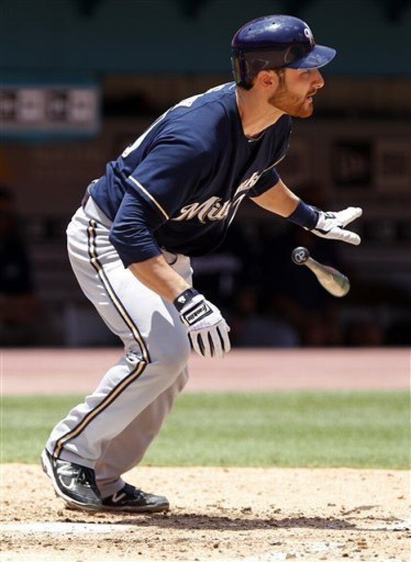 Milwaukee Brewers' Jonathan Lucroy throws his bat after hitting an RBI-single to score teammate Nyjer Morgan in the third inning during a baseball game against the Florida Marlins in Miami, Sunday, June 5, 2011. (AP Photo/Lynne Sladky)