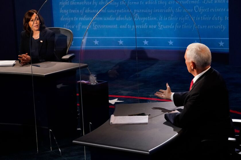 Sen. Kamala Harris and Vice President Mike Pence during the vice presidential debate Wednesday at the University of Utah.