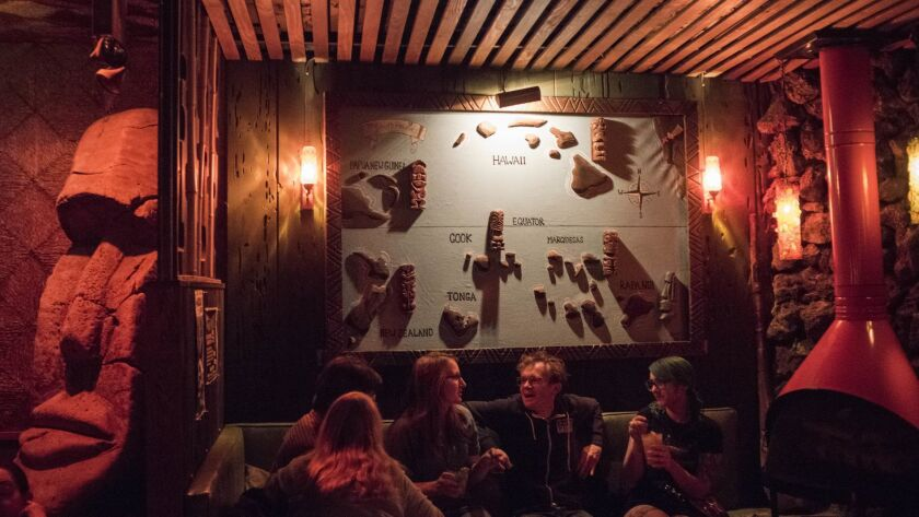 Patrons of Tonga Hut take refuge in the dark and cool environment of the beloved tiki bar in North Hollywood.
