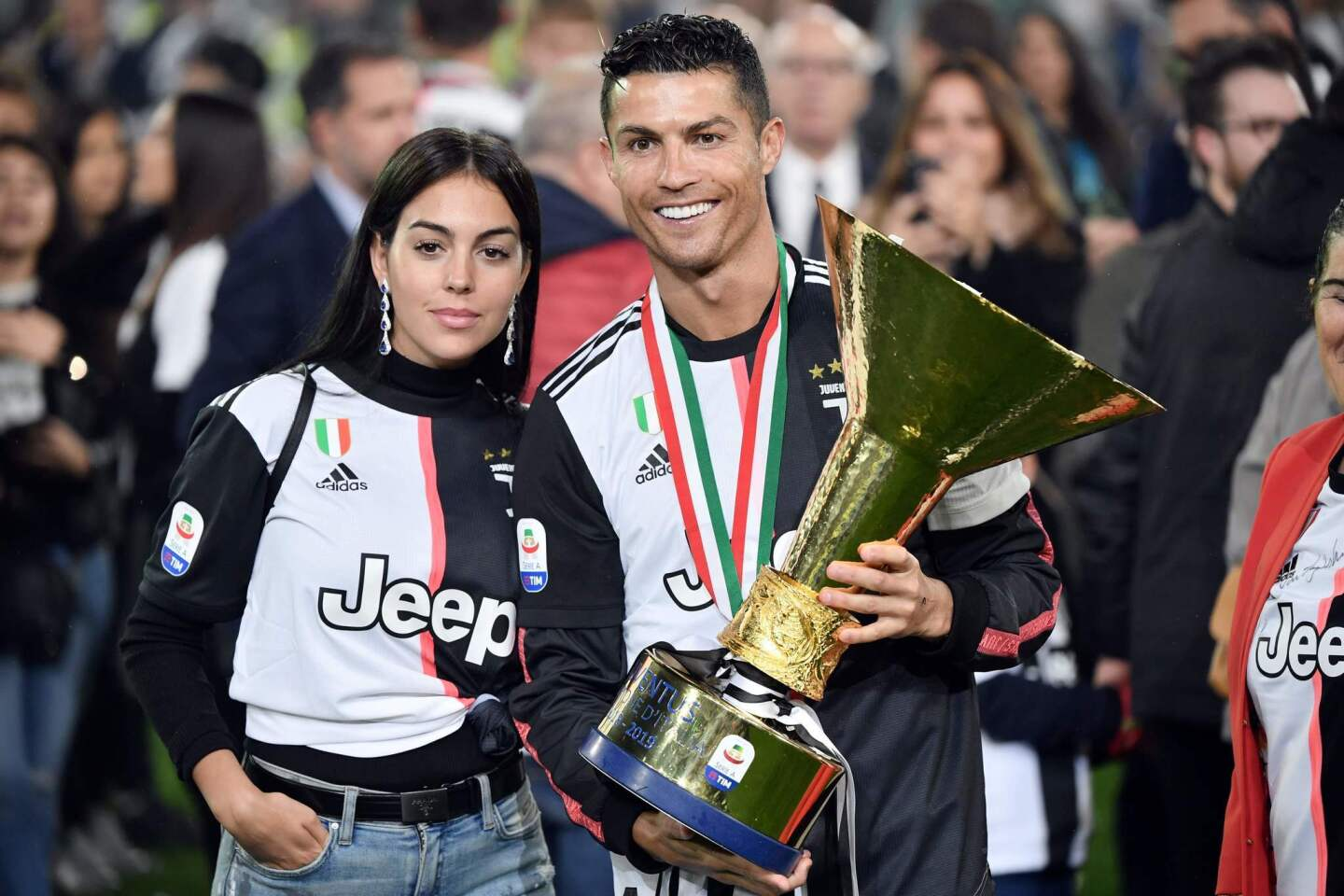 Juventus' Portuguese forward Cristiano Ronaldo holds the Italian Champion's trophy next to his wife Georgina at the end of the Italian Serie A football match Juventus vs Atalanta on May 19, 2019 at the Allianz stadium in Turin. (Photo by Marco Bertorello / AFP)MARCO BERTORELLO/AFP/Getty Images ** OUTS - ELSENT, FPG, CM - OUTS * NM, PH, VA if sourced by CT, LA or MoD **