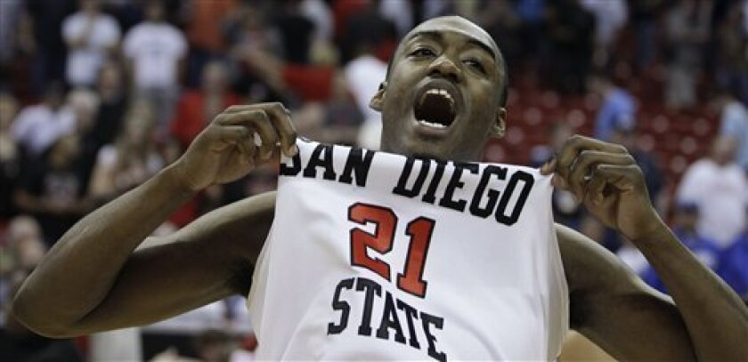 San Diego State's Jamaal Franklin celebrates at the end of an NCAA college basketball game against UNLV in the semifinals of the Mountain West Conference tournament, Friday, March 11, 2011, in Las Vegas.  San Diego State won 74-72. (AP Photo/Julie Jacobson)