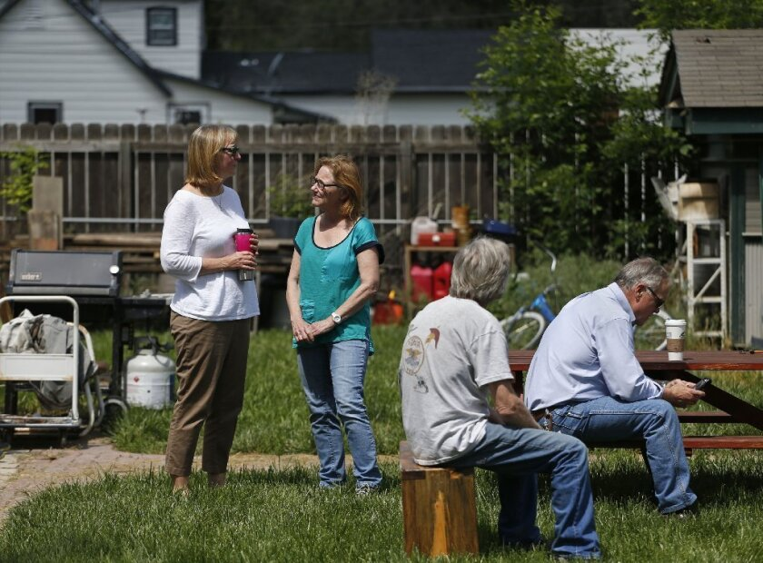 Family members of a man shot and killed in Loveland, Colo., stand together the morning after the attack. Police are concerned the attack may be the latest in a series of seemingly random shootings throughout northern Colorado.