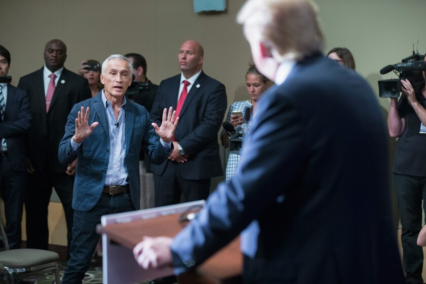 Republican presidential candidate Donald Trump fields a question from Univision and Fusion anchor Jorge Ramos during a news conference held before his campaign event. Earlier in the news conference Trump had Ramos removed from the room after he failed to yield when Trump wanted to take a question from a different reporter.