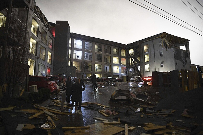Deadly tornadoes ripped across Tennessee early Tuesday, shredding more than 140 buildings and burying people in piles of rubble and wrecked basements.