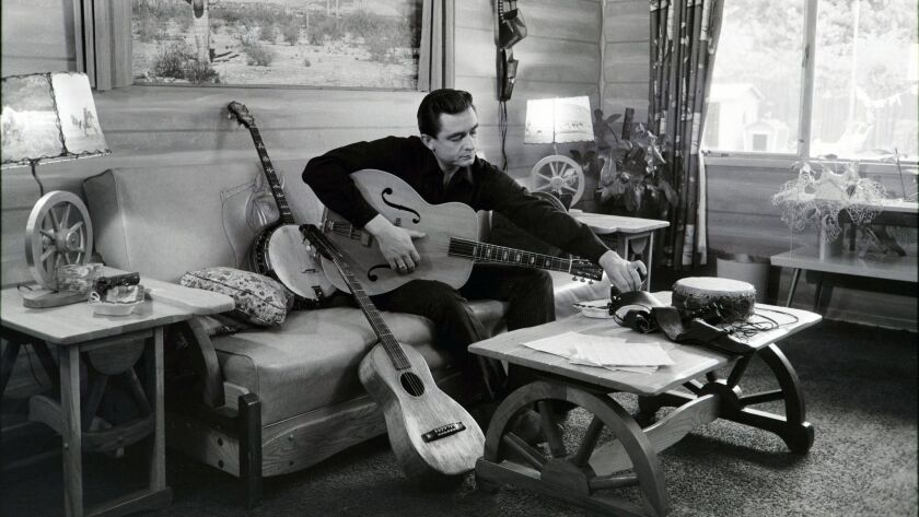 "Johnny Cash, photographed at his home in California in 1960, is among dozens of musicians who figure into Ken Burns' forthcoming PBS documentary ""Country Music."""