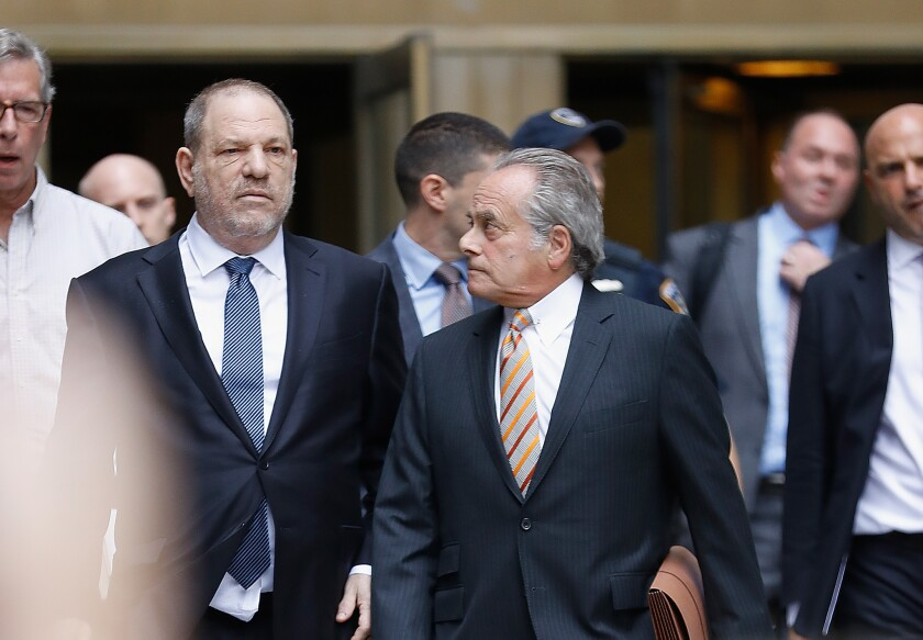 Harvey Weinstein and his lawyer Benjamin Brafman leave criminal court after criminal case hearing on Oct. 11, 2018, in New York City.
