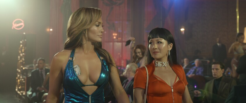 "Jennifer Lopez, left, and Constance Wu in ""Hustlers"""