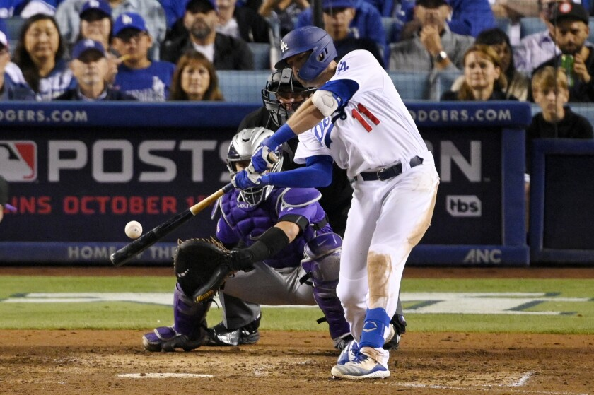 The Dodgers' A.J. Pollock hits a three-run homer in the Dodgers' seven-run fourth inning Sept. 20, 2019.