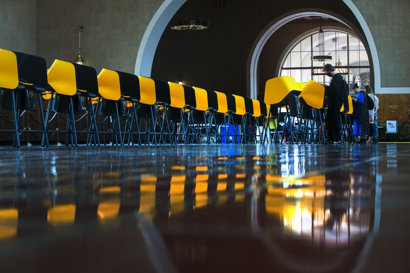 Voters cast their ballots at Union Station in Los Angeles on Tuesday.