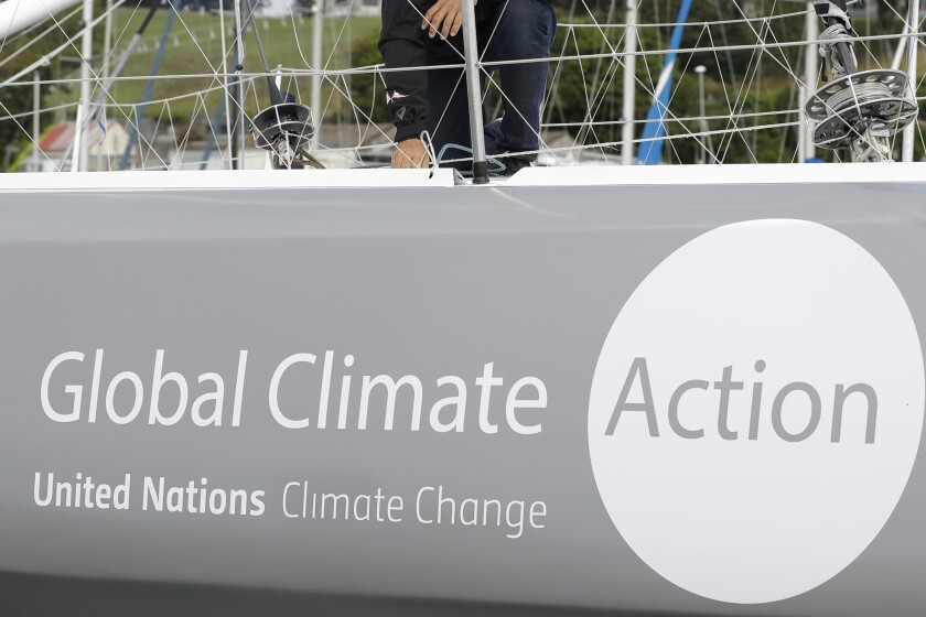 FIE - This Aug. 13, 2019, file photo, shows the boat Malizia as it is moored in Plymouth, England Tuesday, Aug. 13, 2019. A group of more than 500 major institutional investors is urging governments to do more to tackle climate change, ahead of a U.N. summit on the issue. (AP Photo/Kirsty Wigglesworth, File)