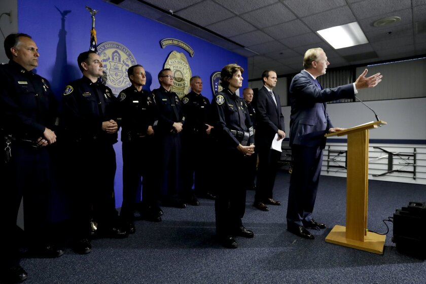 San Diego Mayor Kevin Faulconer speaks at a news conference in front of San Diego Police Chief Shelley Zimmerman, third from right, police Captain David Nisleit and other police officials Friday, July 15, 2016, at San Diego police headquarters.