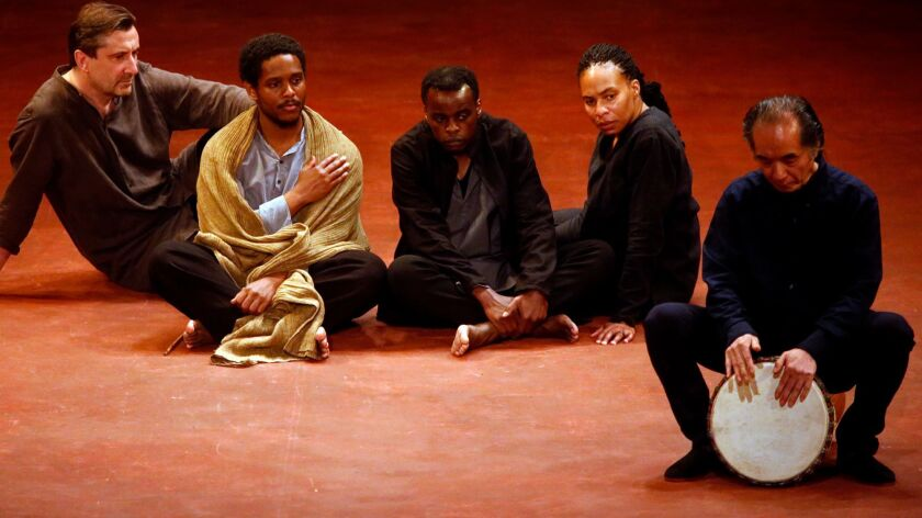 """From left, Sean O'Callaghan, Jared McNeill, Ery Nzaramba, Karen Aldridge and Toshi Tsuchitori perform the final scene of Peter Brook's """"Battlefield"""" at the Wallis Annenberg Center for the Performing Arts."""