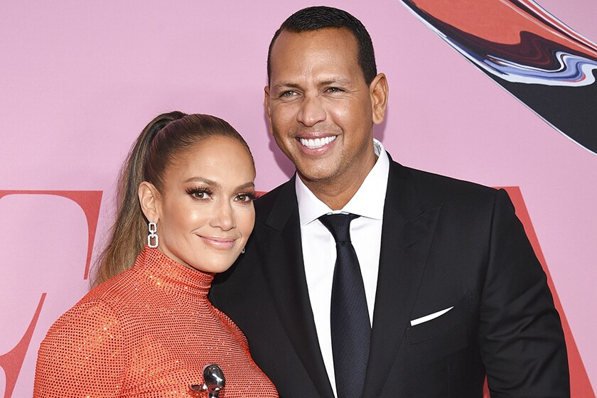 Jennifer Lopez and Alex Rodriguez pose for a photo.