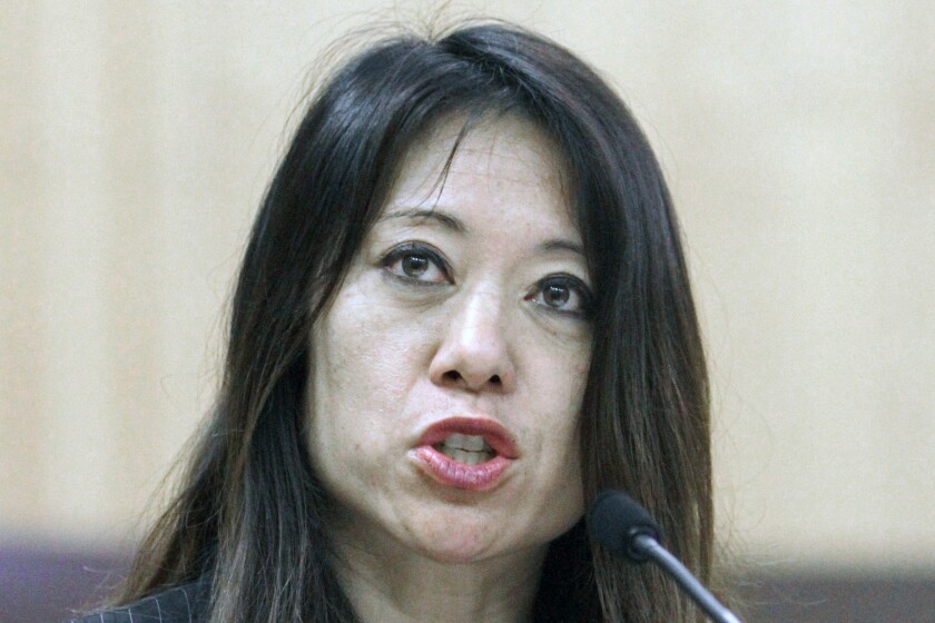 """This June 14, 2011, file photo then-Assemblywoman Fiona Ma, D-San Francisco, speaks at a hearing at the Capitol in Sacramento, Calif. Ma, now the state treasurer, is facing a lawsuit alleging she sexually harassed an employee while sharing a hotel room. Ma says the lawsuit's allegations are """"without merit."""" (AP Photo/Rich Pedroncelli, File)"""