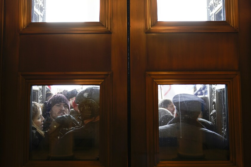 Rioters outside doors of U.S. Capitol on Jan. 6