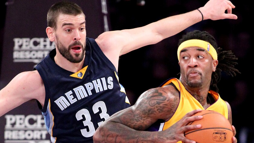 Lakers forward Jordan Hill, right, works in the post against Memphis Grizzlies center Marc Gasol during the first half of a game on Nov. 26 at Staples Center.