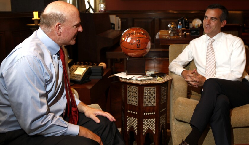 Steve Ballmer, left, talks with Mayor Eric Garcetti at Los Angeles City Hall on Friday afternoon about his pending purchase of the Clippers.