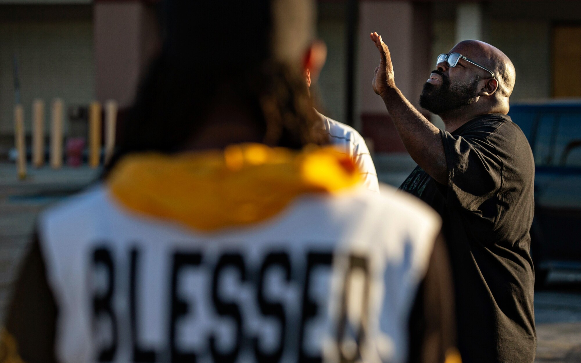 Pastor Donovan Price leads a prayer circle on the South Side of Chicago.