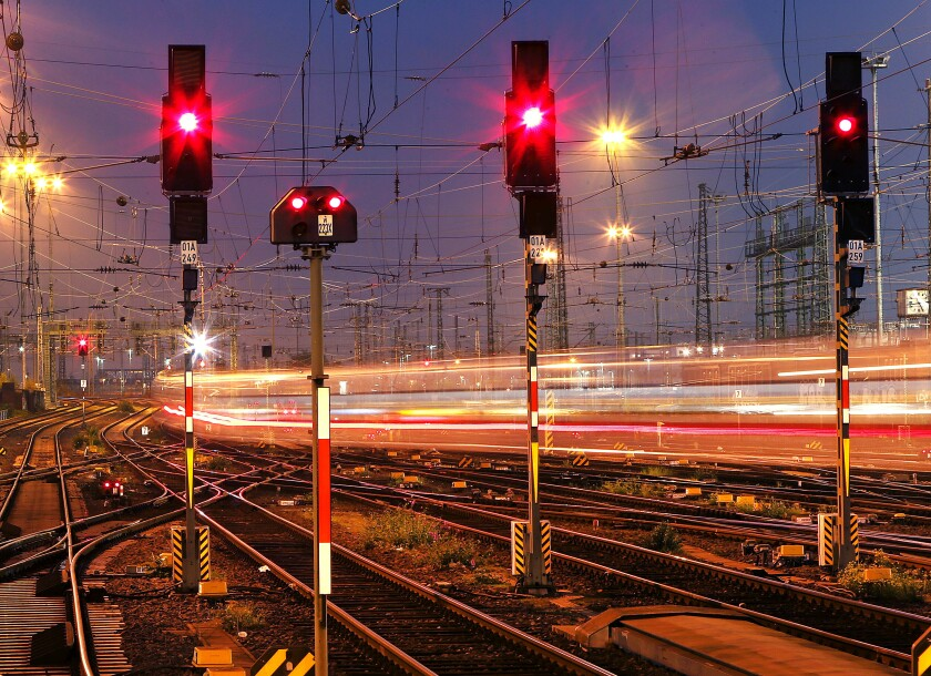 FILE - In this Wednesday, Oct. 17, 2018 file photo a train leaves at night the main train station in Frankfurt, Germany. Four European rail companies announced Tuesday they plan to boost the continent's network of night train connections by reviving routes that were dropped several years ago for cost reasons. (AP Photo/Michael Probst, File)