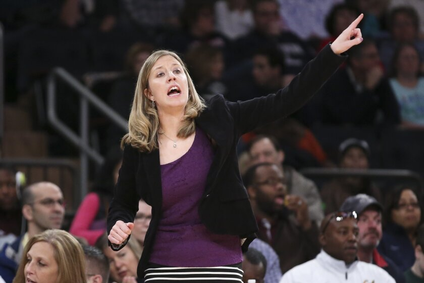 California head coach Lindsay Gottlieb directs her players from the bench during the first half of their NCAA college basketball game against Connecticut as part of the Maggie Dixon Basketball Classic at Madison Square Garden, Sunday, Dec. 22, 2013, in New York. Connecticut defeated California 80-4