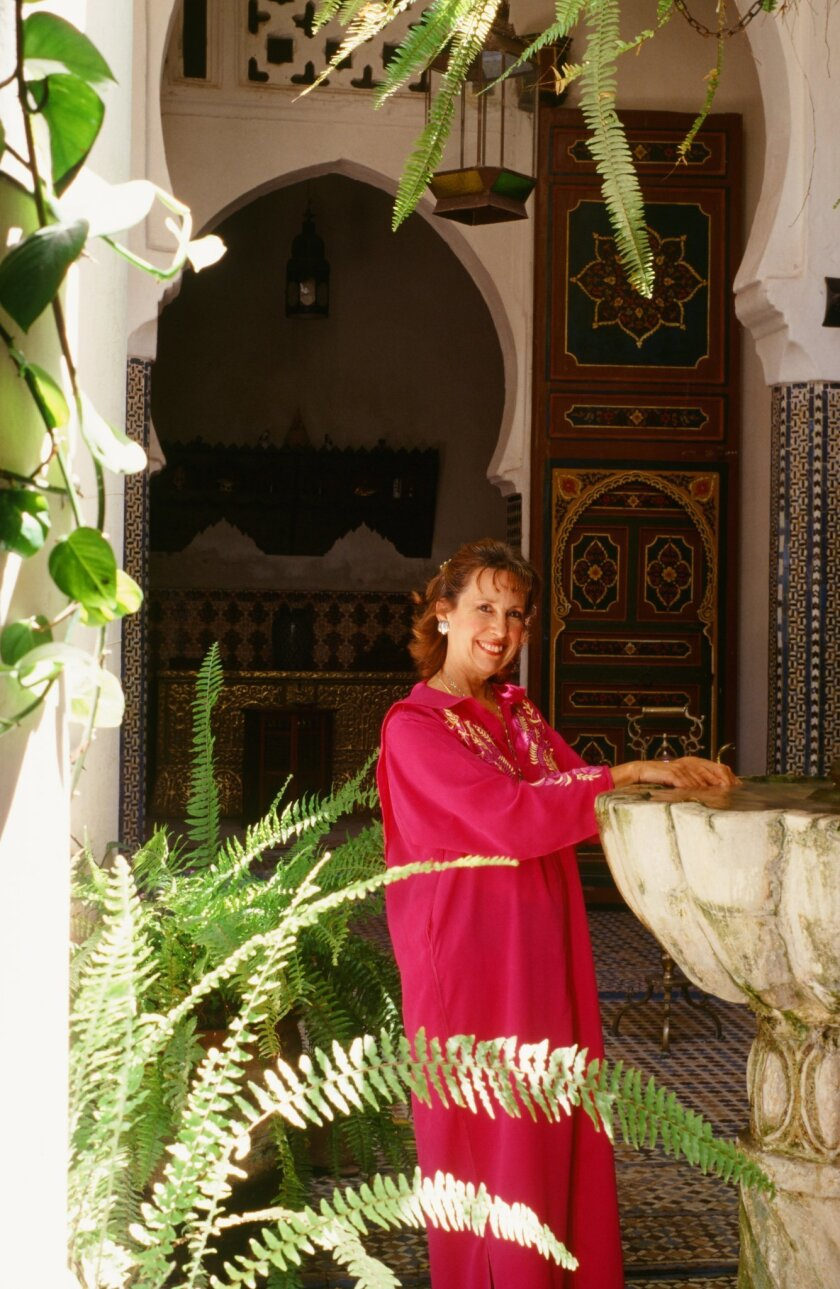 """Cookbook author Kitty Morse at the atrium fountain in Dar Zitoun, the mansion she writes about in her memoir with recipes, """"Mint Tea and Minarets."""" CREDIT: Owen Morse"""