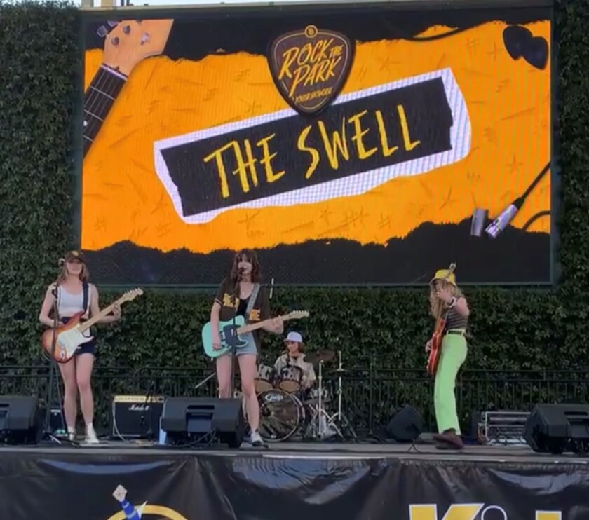 The Swell band performing at Petco Park.