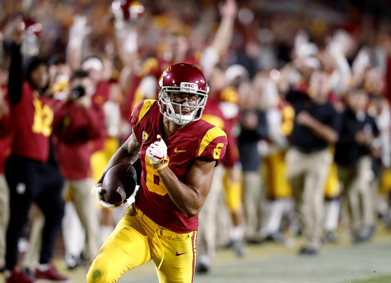 USC wide receiver Michael Pittman heads to the end zone for his first touchdown of the second quarter against Colorado on Saturday night at the Coliseum.