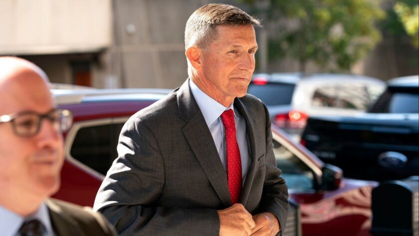 Michael Flynn, the former National Security Advisor, walks into the Federal courthouse in Washington on July 10.