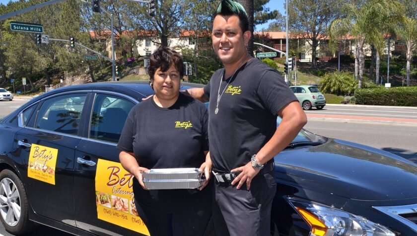 Bety and Luis Gracida pose after delivering food. The Gracidas started Bety's Catering while looking for a new brick-and-mortar location for Bety's Tacos, among the recent business closures in Encinitas.