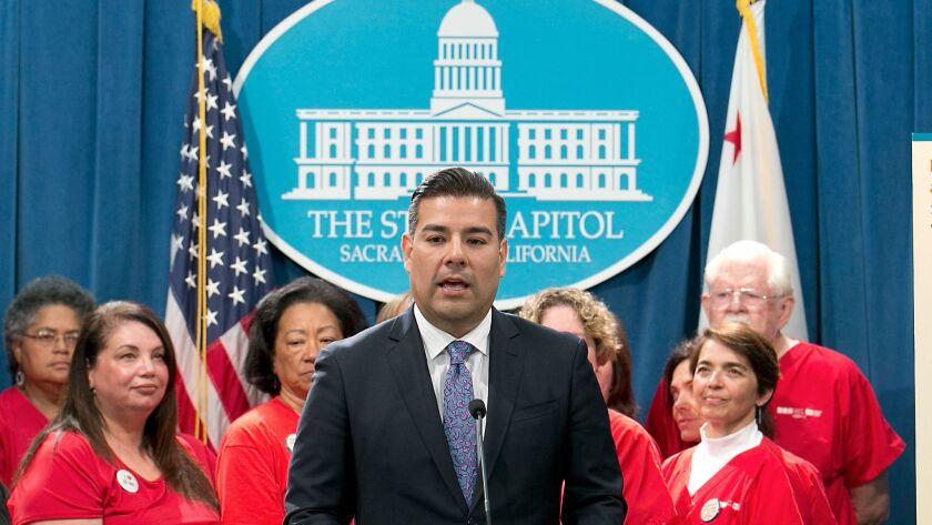 State Sen. Ricardo Lara, D-Bell Gardens, accompanied by members of the California Nurses Association
