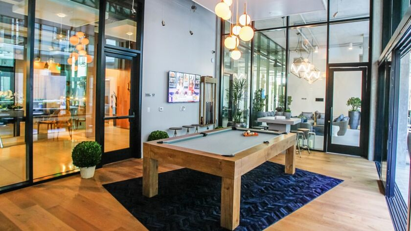 SAN DIEGO, CA February 23rd 2018 | This is a game room with a pool table at the Alexan ALX luxury ap