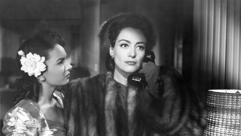 "(L-R) - Ann Blyth as Veda Pierce and Joan Crawford as Mildred Pierce in ""MILDRED PIERCE (1945),"" dir"