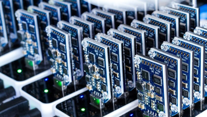 In bitcoin mining, individuals or groups get paid in new bitcoins to run complex mathematical equations on high-powered computers in order to confirm the validity of transactions.