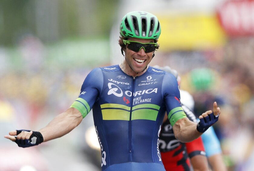Australia's Michael Matthews celebrates as he crosses the finish line to win the tenth stage of the Tour de France cycling race over 197 kilometers (122.4 miles) with start in Escaldes-Engordany, Andorra, and finish in Revel, France, Tuesday, July 12, 2016. (AP Photo/Christophe Ena)