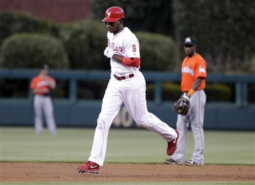 Philadelphia Phillies' Domonic Brown (9) runs the bases after he hit a solo home run against the Miami Marlins in the second inning of a baseball game on Thursday, May 2, 2013, in Philadelphia. (AP Photo/H. Rumph Jr)