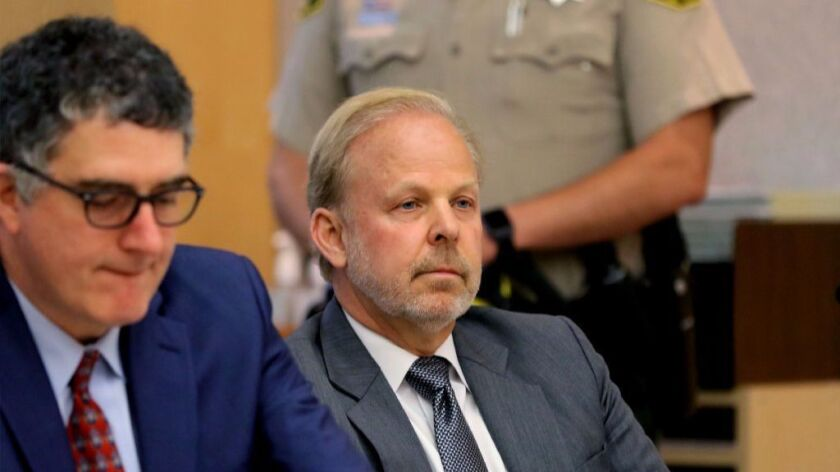 In this May 1 file photo, Robert O. Young, at right, sits with defense attorney Wil Rumble during a