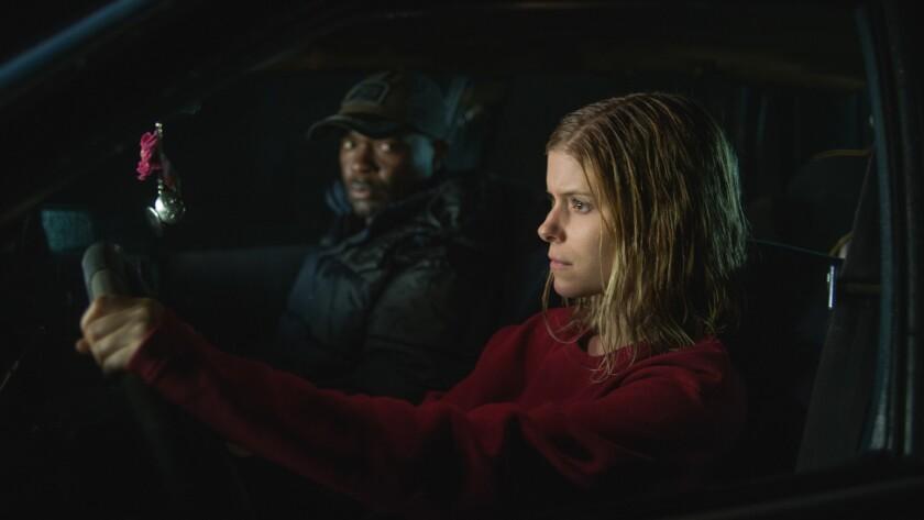 "David Oyelowo and Kate Mara in ""Captive."""