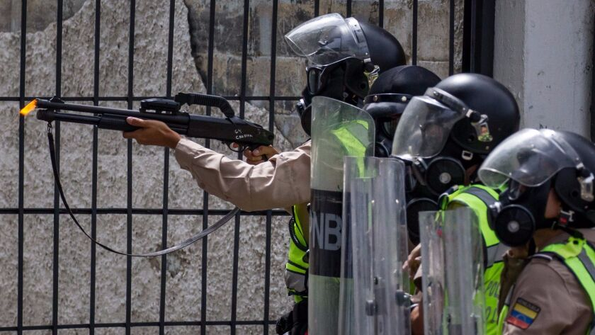 Police face off with protesters Wednesday during a demonstration against the government of President Nicolas Maduro in Caracas, Venezuela.